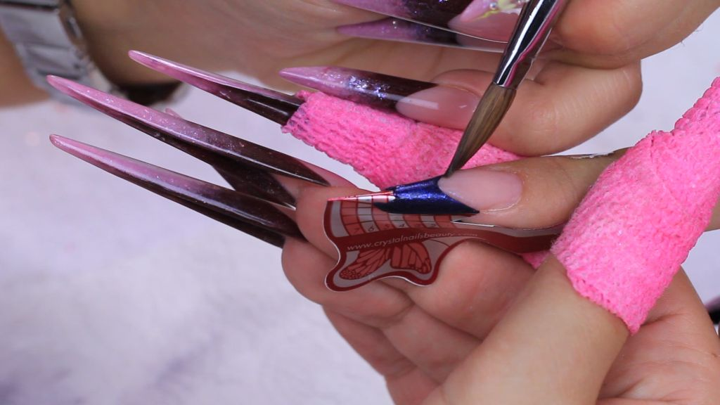 Create the free edge with 624 powder then thin it towards the top of the nail