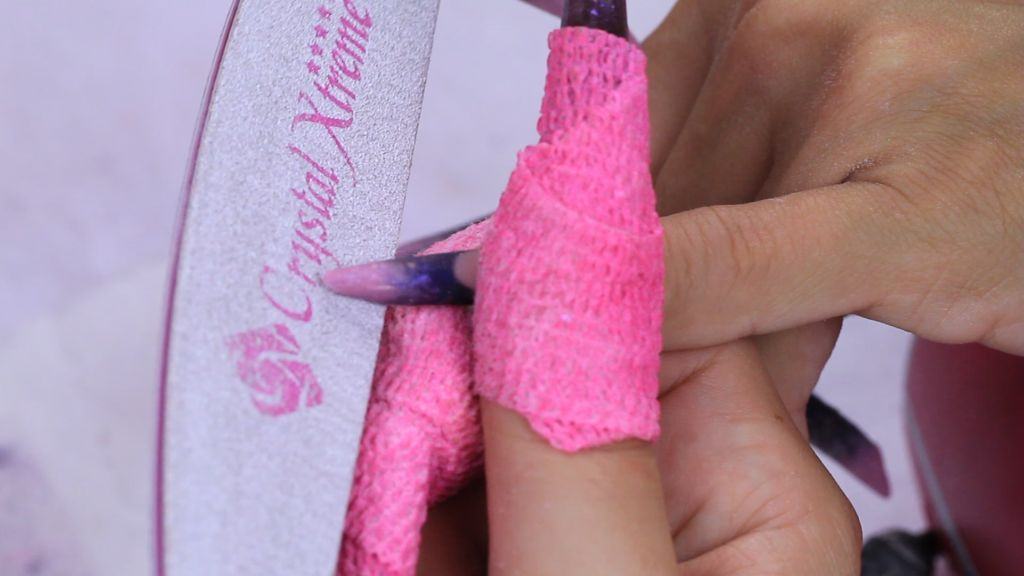 Shape the free edge with Xtreme Pink file
