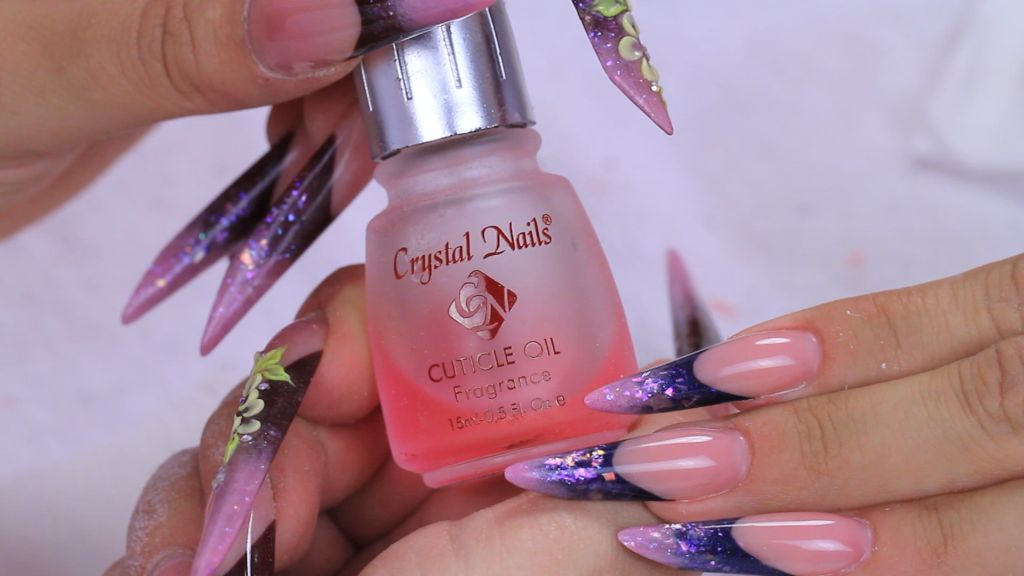 Apply cuticle oil to the cuticle area