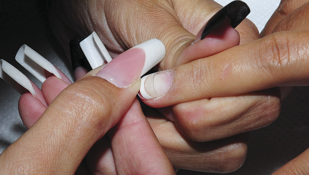 Secure the Crystal Nails Mani Tip to the natural nail's free edge, and hold it for a few seconds. Press firmly against the free edge, to be sure, it's securely adhered. Be sure, that the tip is fitting side to side to the natural nail's surface, and the smile line is in the right place, and direction.