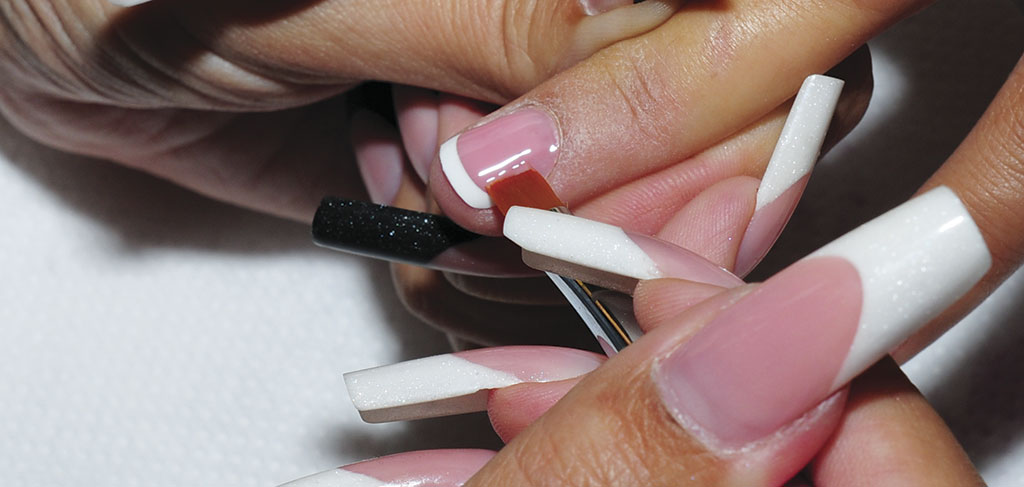 Refine the smile line with a clean brush, and double check, the cover gel is separated from the tip.